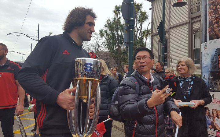 Crusaders players mingle with the public during the Super Rugby victory parade.