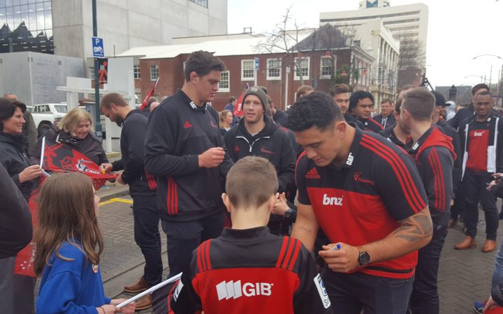 Crusaders players with fans in Christchurch today.