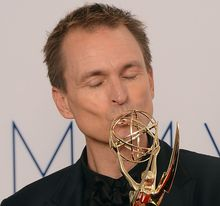 Phil Keoghan celebrates winning an Emmy for the Amazing Race in 2012.