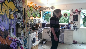 Conor Dunlevey surveys the mess at his friend's house in Christchurch.