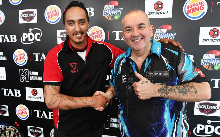 "NZ's Darren Herewini aka Apocalypse and Phil "" the power"" Taylor match up in the first round of Auckland Darts Masters Thursday 10 August 2017."