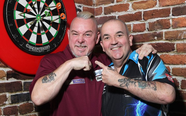 "Peter Wright aka Snakebite with Phil "" the power"" Taylor."