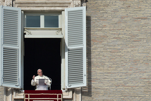 Pope Francis addresses the crowd in St.Peter's Square on 1 January.
