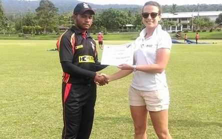 PNG'S Vai Karaho is presented with his player of the match award