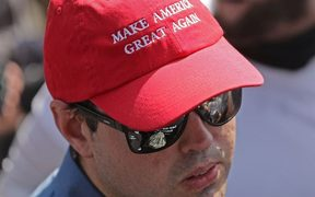 "A man wears a 'Make America Great Again' hat during the ""Unite the Right"" rally."
