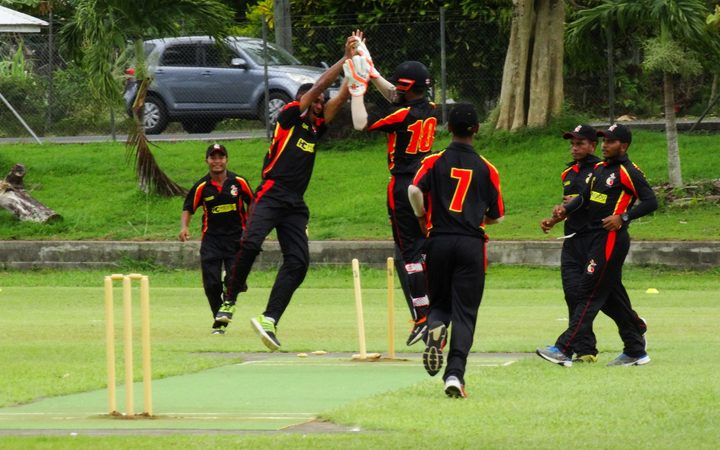 The PNG Garamuts celebrate a wicket in their win over Fiji.