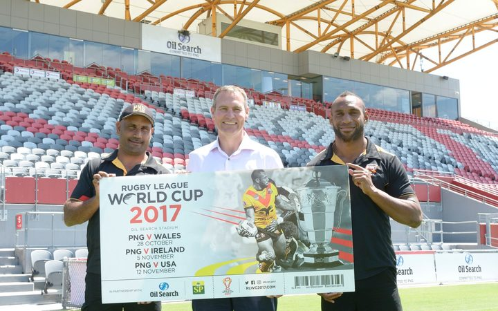 PNG coach Michael Marum, Rugby League World Cup CEO Andrew Hill and Kumuls fullback Stargroth Amean promote cheap ticket prices in Port Moresby.