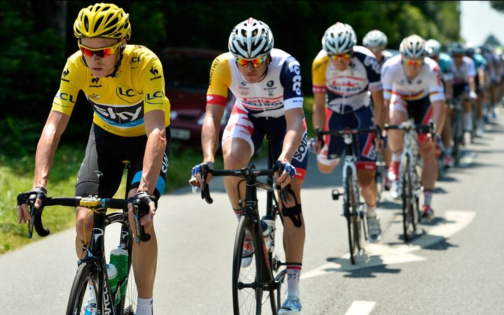 Greg Henderson tucks in behind yellow jersey holder Chris Froome during the 2013 Tour de France.