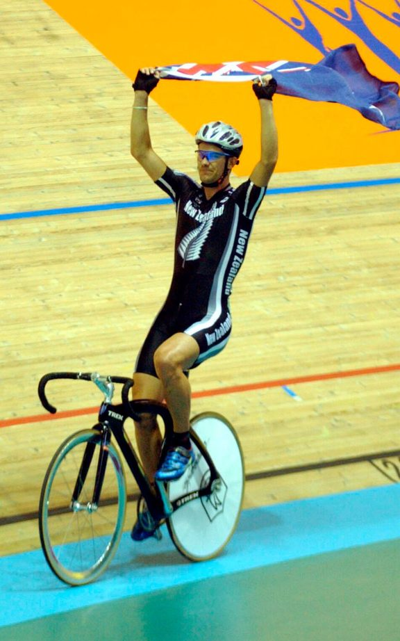 Greg Henderson celebrates winning gold at the 2002 Manchester Commonwealth Games.