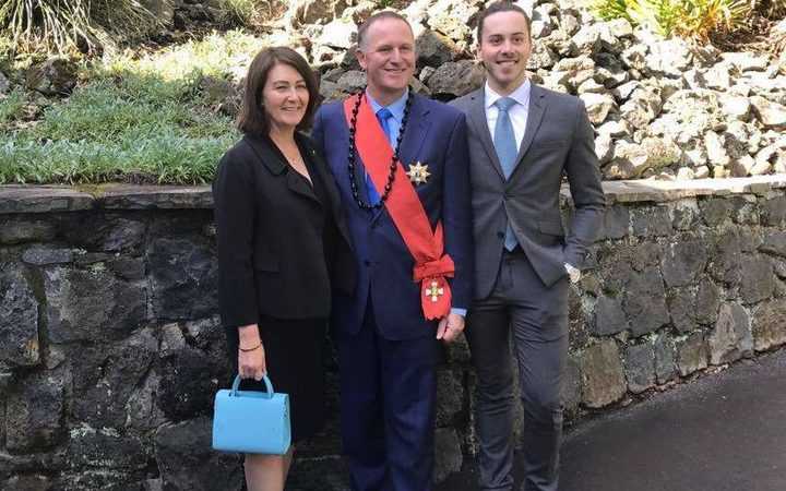 Sir John Key, after his investiture at Government House, with wife Bronagh and son Max