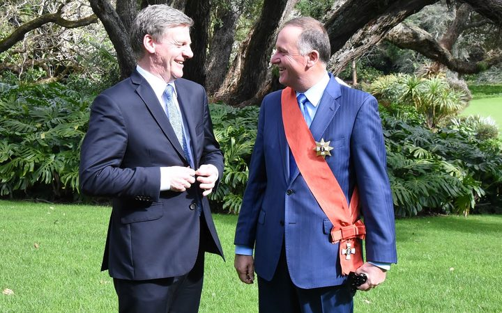 Former PM Sir John Key (right), talking after his investiture with current PM Bill English.