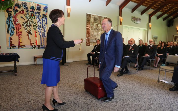 Sir John Key is knighted by Dame Patsy Reddy.