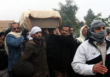 The coffin of a man killed in fighting is being carried for burial in Fallujah.