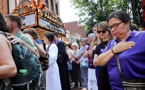 Clergy observe a moment of silence during the memorial service for Heather Heyer outside the Paramount Theater in Charlottesville, Virginia.
