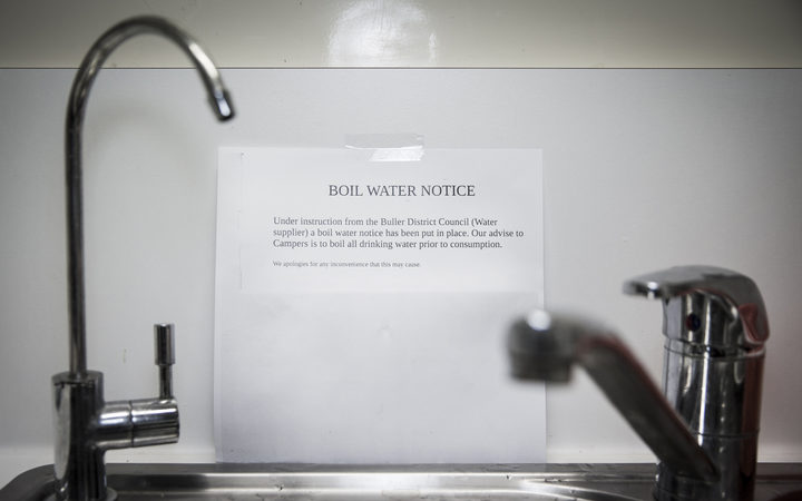 notice on wall behind a sink