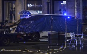 The van that was driven into the crowd, killing at least 13 people, is towed away from Las Ramblas in Barcelona
