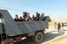 Sunni Muslim families leave their homes in Fallujah on Monday.