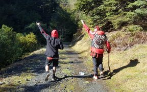 Members of the Mongrel Mob search for two of their friends, lost in the Kaimanawa Forest since the weekend.