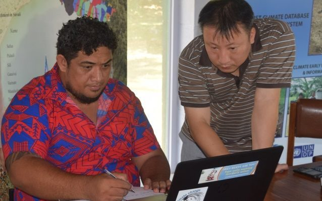 Principal Scientific Officer, Tile Tofaeono running the Climate Prediction software with team from APEC Climate Center.