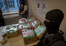 Police and custom officers guard the cocaine found crates of imported bananas.