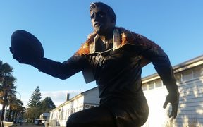 A korowai has been placed around the statue of Sir Colin Meads in Te Kuiti.