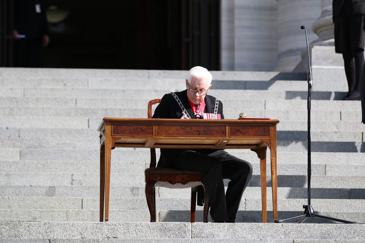 New Zealand Herald of Arms Extraordinary to the Queen Phillip O'Shea signs the proclamation dissolving the 51st Parliament.