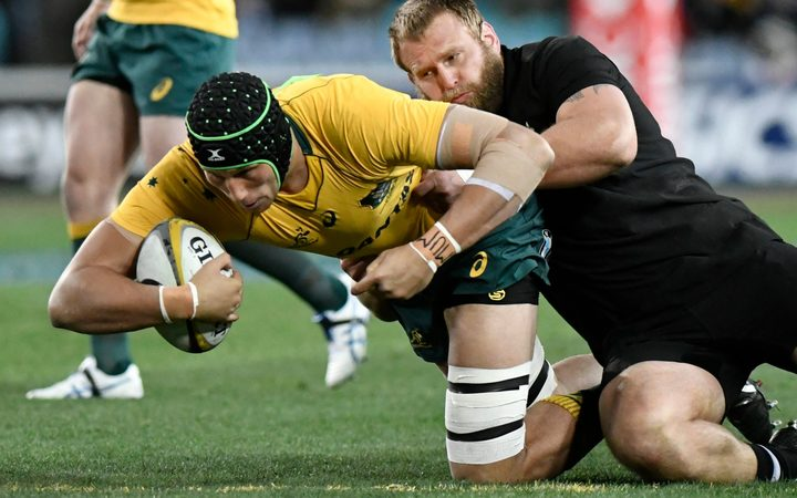 Wallabies lock Adam Coleman is tackled by All Black prop Joe Moody in the first Bledisloe Cup test in Sydney