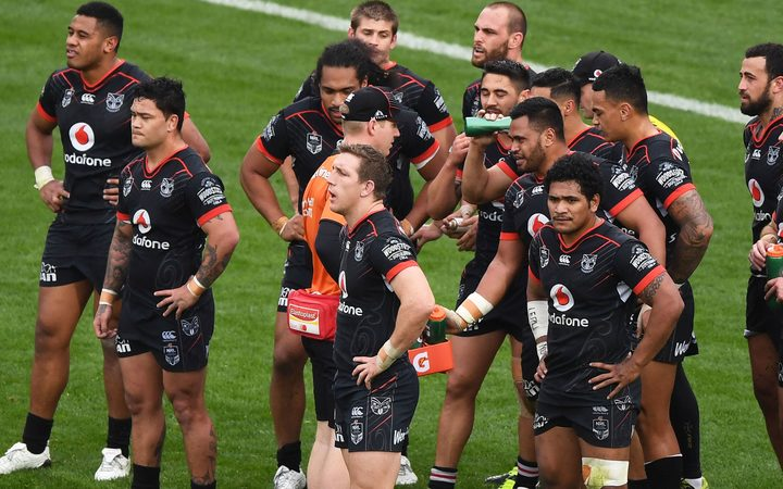 Warriors players wait for a Manly conversion