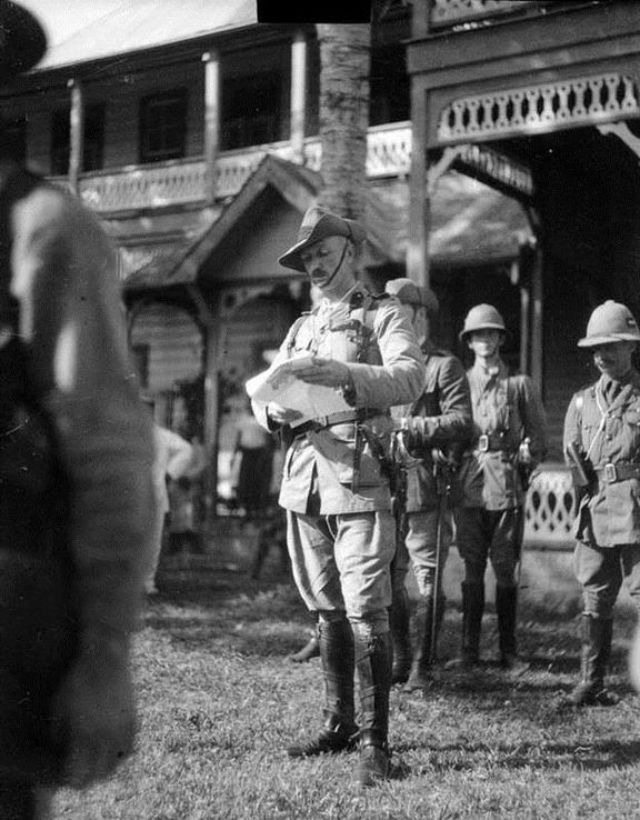 """Administrator of Samoa, Colonel Robert Logan, reading a Proclamation of occupation at the flag-raising ceremony in Apia on 30 August 1914 (31 August Eastern time). This was the morning after the occupation of German Samoa by the New Zealand Expeditionary Force."""