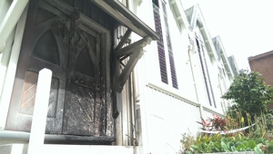 One of the doors to the church is charred.