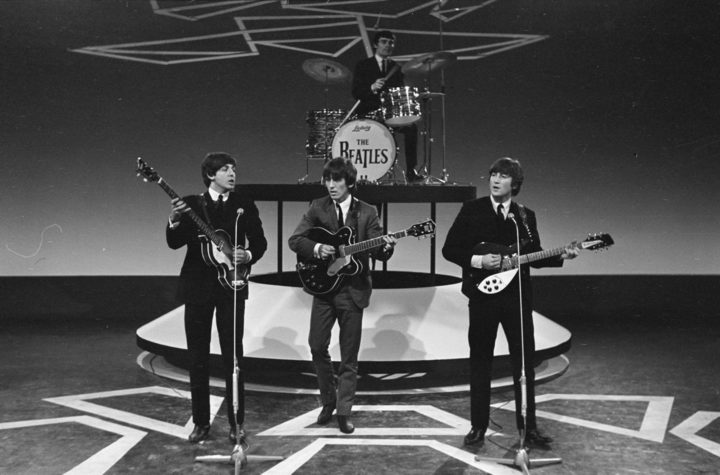 The Beatles performing in 1964