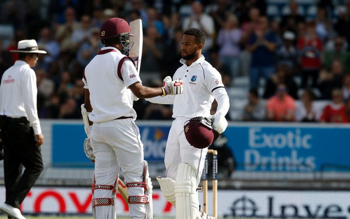 West Indies batsman Shai Hope is congratulated by batting partner Kraigg Brathwaite