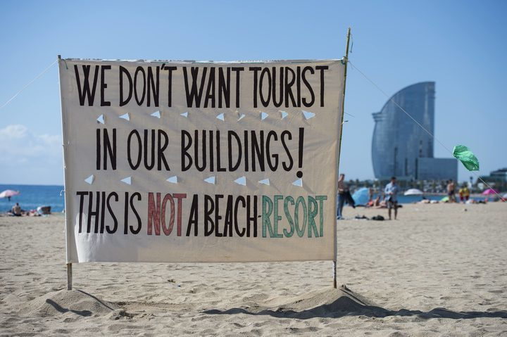 "An anti-tourism banner on La Barceloneta beach during a demonstration against ""drunken tourism"" called by the residents of La Barceloneta neighbourhood in Barcelona, on August 12, 2017."