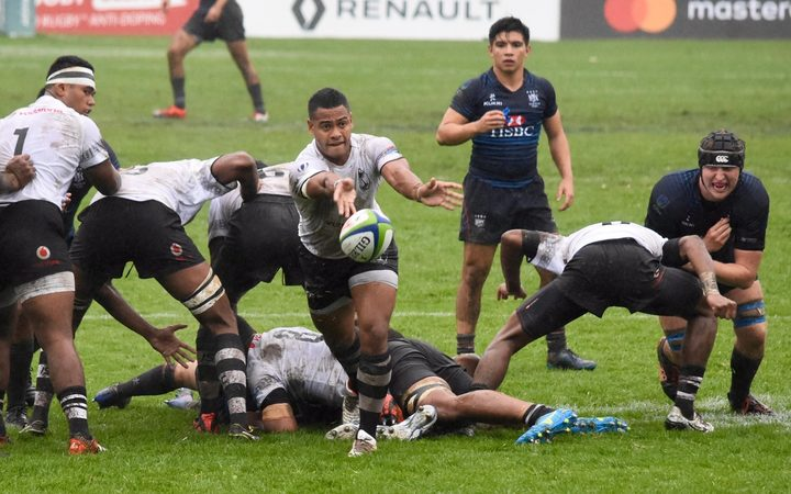 Fiji feeds the ball to the backs in their first up win over Hong Kong at the Junior World Trophy.