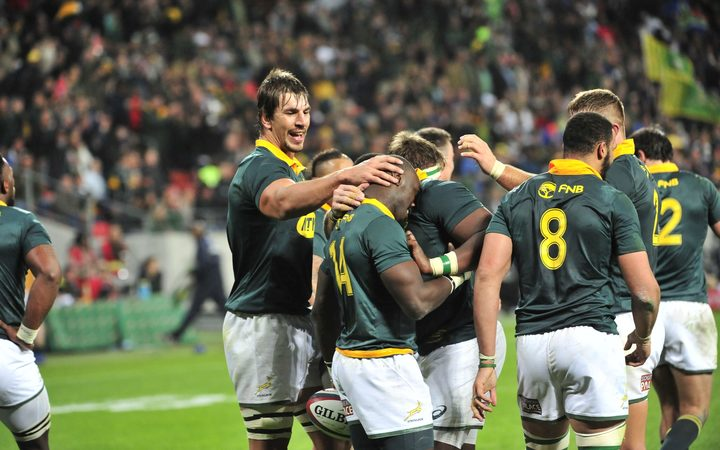 Springboks celebrate a try against the Pumas