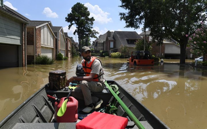 Volunteer rescuer Matt Clarke searches for local residents after a mandatory evacuation was ordered in the area beneath the Barker Reservoir.