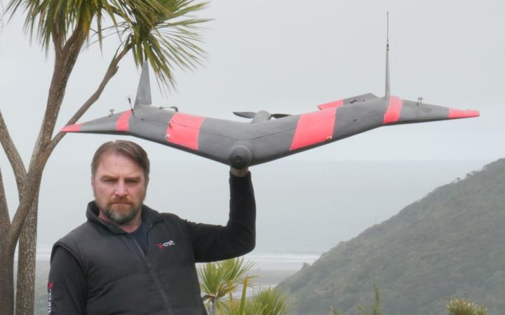 Philip Solaris with a Valkyrie drone outfitted to collect information from the sensors.
