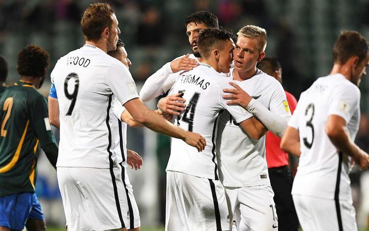 All Whites player Ryan Thomas celebrates his goal with team mates.