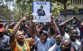 Supporters of Kenya's National Super Alliance (NASA) celebrate after the Supreme Court ordered a re-run of the 8 August presidential poll.
