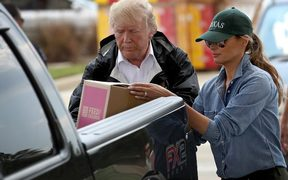US President Donald Trump and first lady Melania Trump help load emergency supplies while visiting Texas.