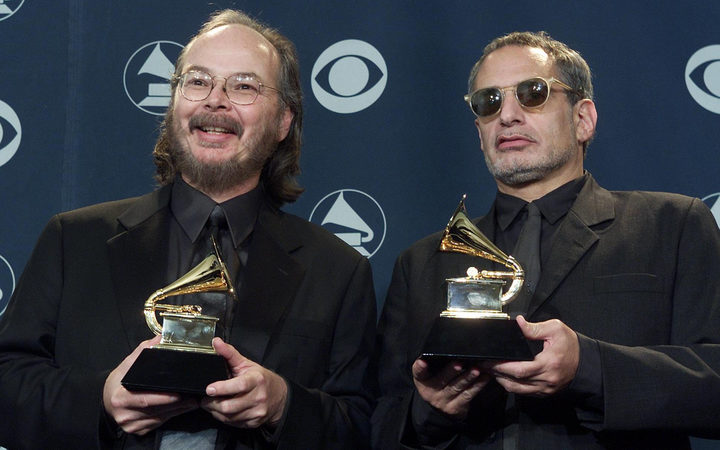 Walter Becker and Donald Fagen accept Grammy awards for Steely Dan's Two Against Nature album, which won both best album and best pop vocal album in 2001.