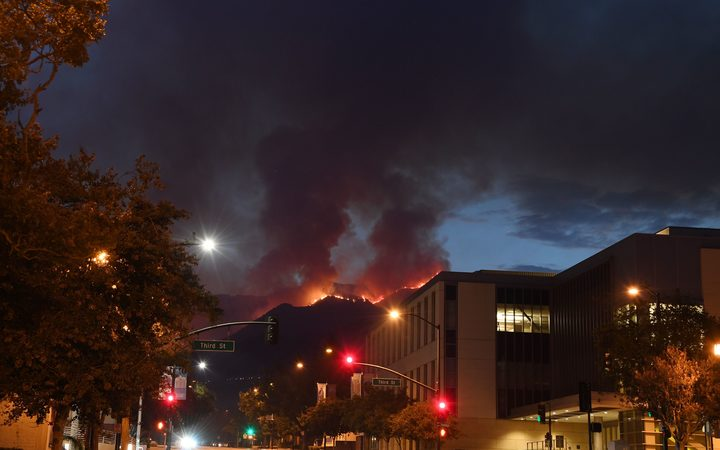 The La Tuna fire burns above downtown Burbank.