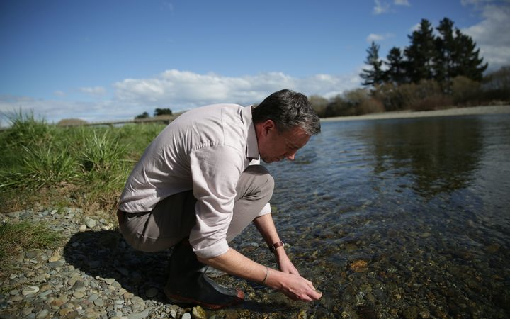 Ian Telfer checks out the Oreti River, after Prime Minister Bill English said he would still swim in it.