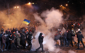 Protesters clash with riot police in the Ukrainian capital, Kiev.