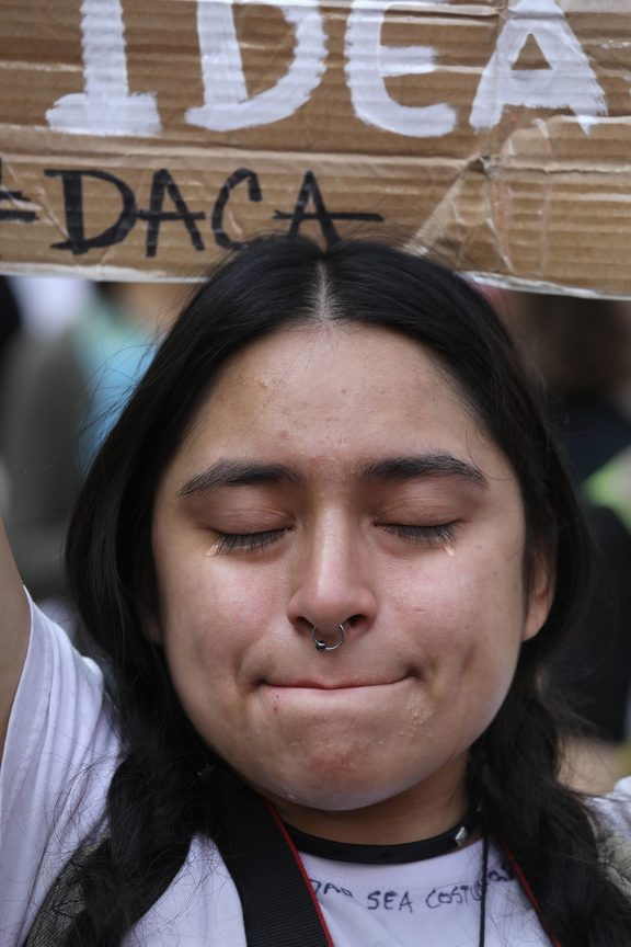 """Dreamer"" Gloria Mendoza, 26, tries to hold back tears after learning that President Trump had ended the DACA program on September 5, 2017 in New York, United States. Mendoza, who said she came with her undocumented parents from Mexico City when she was 9, will face possible deportation."