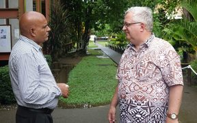 Unitech vice-chancellor Albert Schram (right) talks to a colleague on the institution's Lae campus