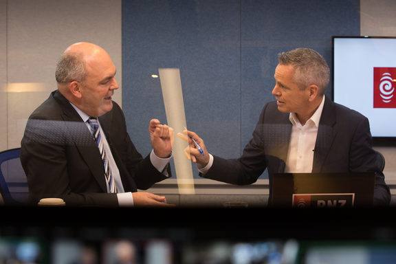 National's Steven Joyce, left, RNZ host Guyon Espiner, right, in Morning Report's Auckland studio.