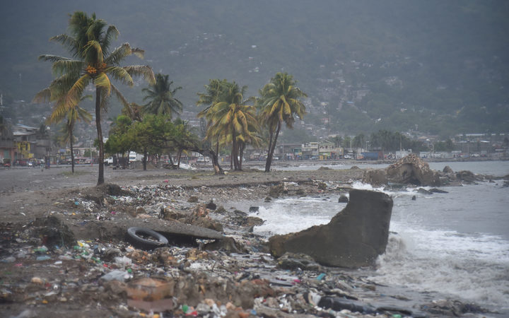 Debris and trash is seen on a beach in Cap-Haitien on the north coast of Haiti.