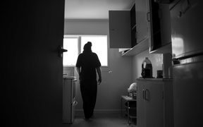 Man silouhetted in flat kitchen
