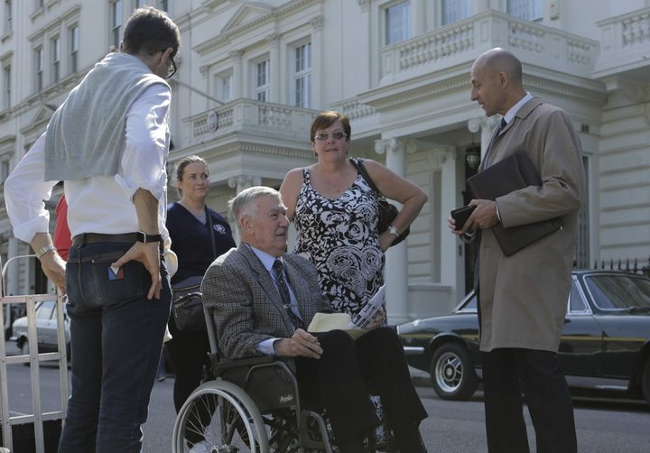 Max Vernon (wheelchair) talks to actor Mark Strong on the set of 6 Days.